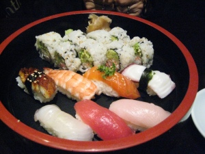 Sushi combo: cali roll, eel, shrimp, salmon, octopus, yellowtail, tuna, and mackrel